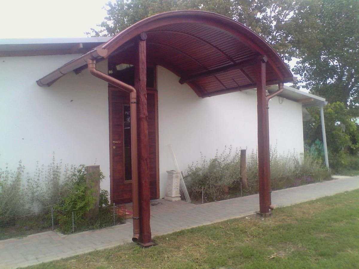 Wood and curved glass shelter